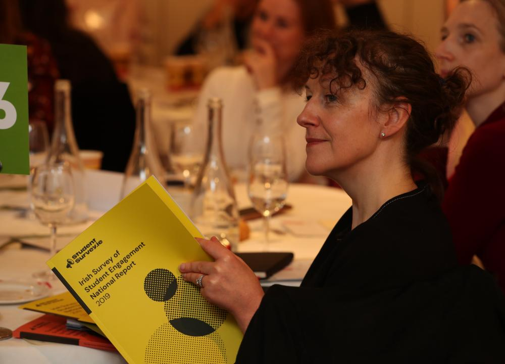 Person reading report at launch